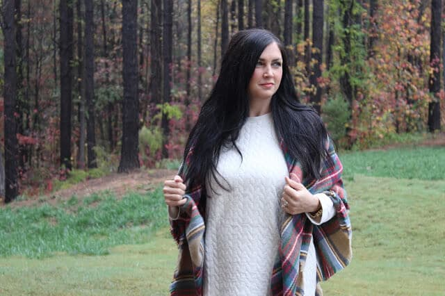 Quilted sweatshirt, plaid blanket scarf, fringe boots