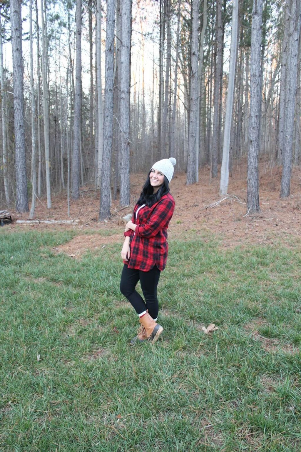 red and black plaid shirt, duck boots, pom pom beanie