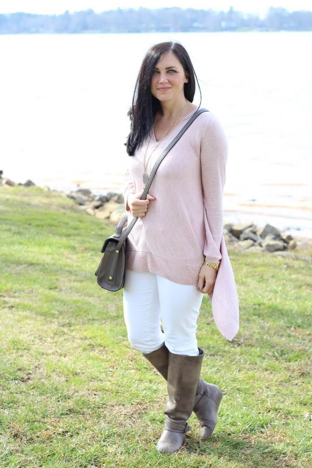 Pink sweater, white jeans, grey cross body