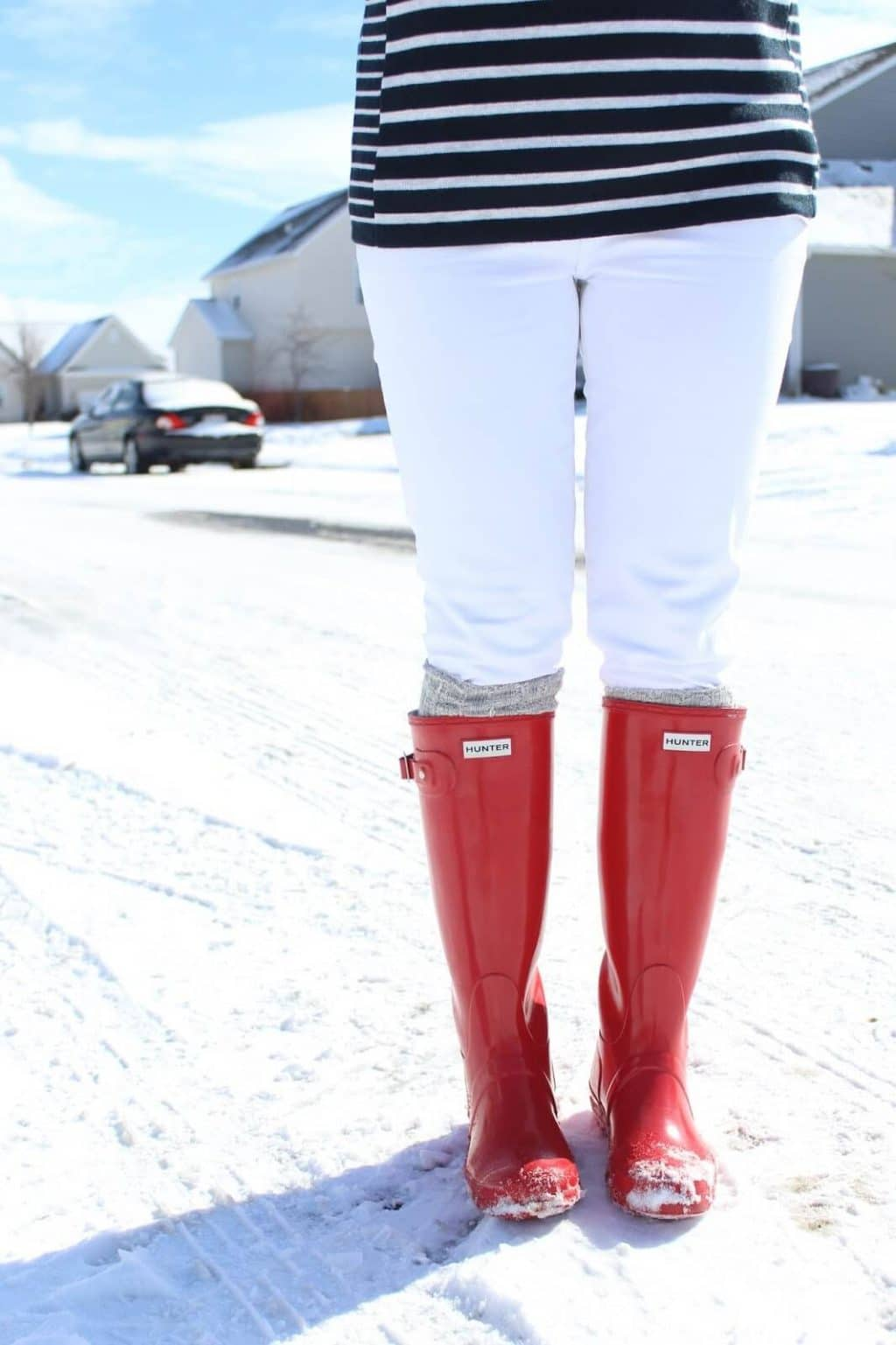 red hunter boots, white jeans, striped sweater