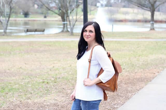 White sweater, cognac backpack, skinny distressed jeans. @Jjillstyle