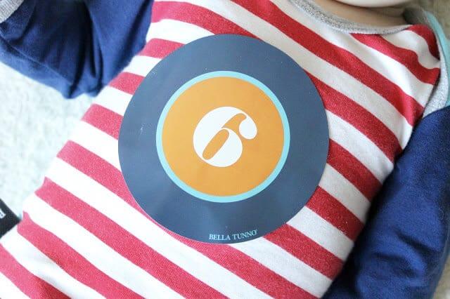 6 month sticker onesie via Bella Tunno