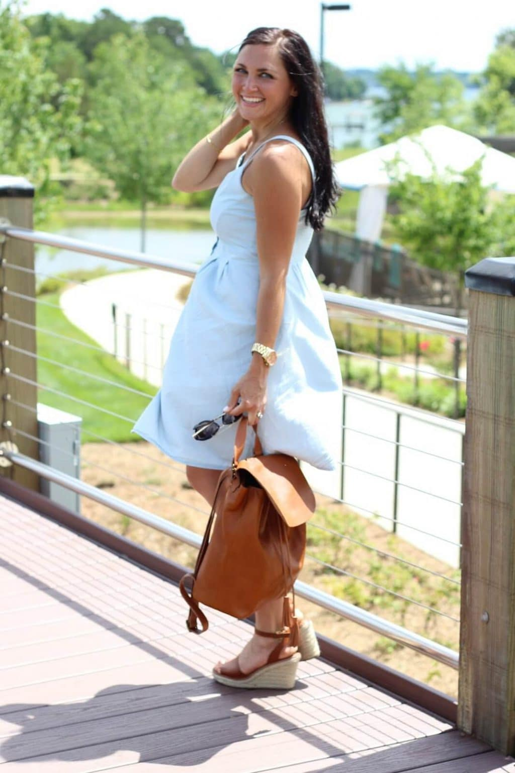 Tan backpack, chambray dress, tan espadrilles