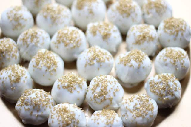 Oreo Ball Truffles are an easy, yet beautiful dessert that can be customized for any party or holiday!