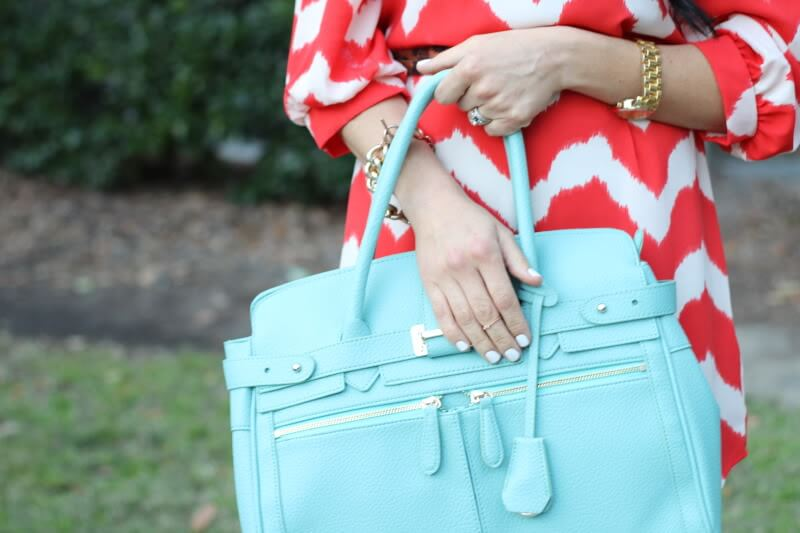 Mint bag, coral dress