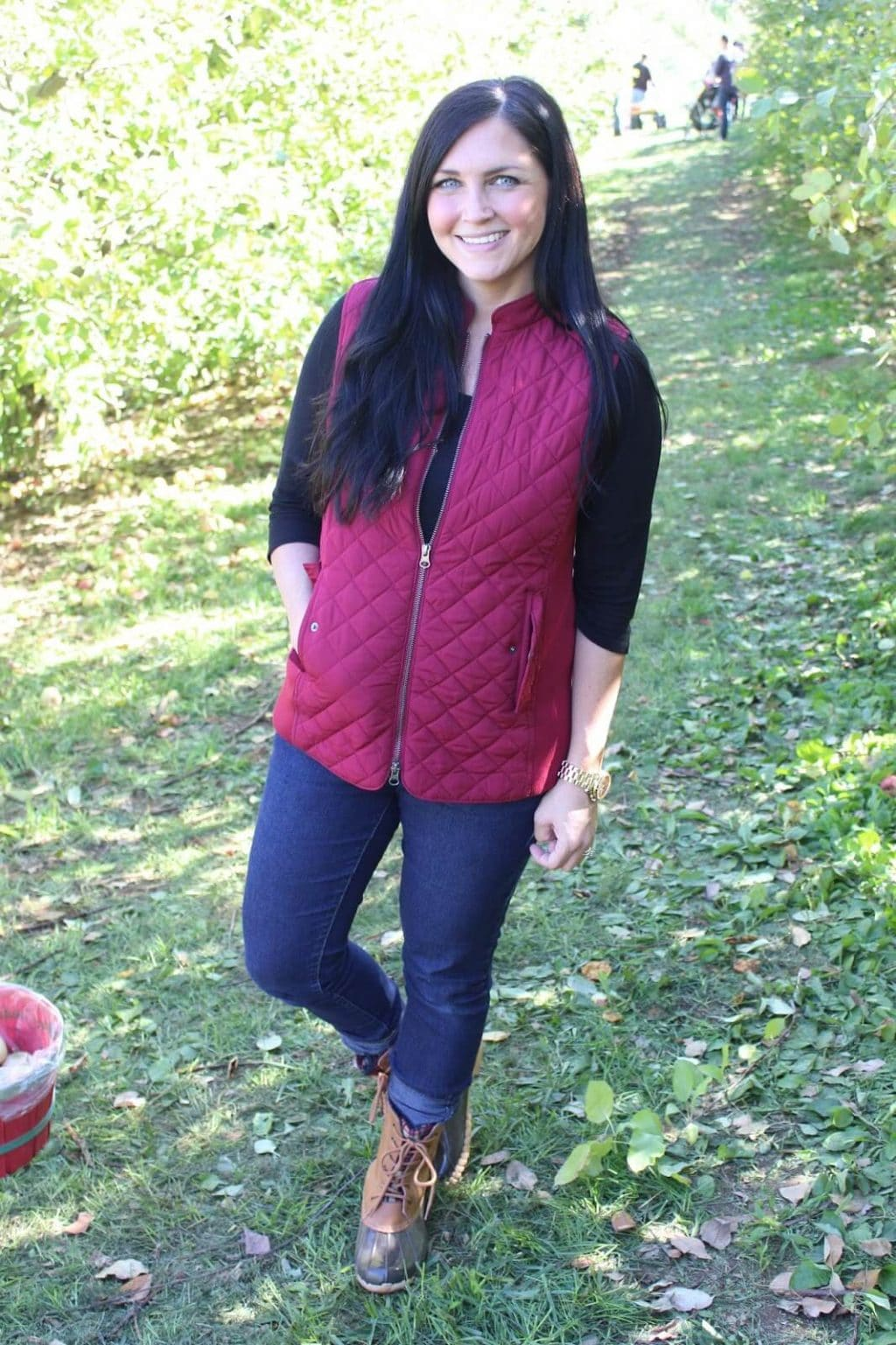 duck boots, red puffy vest, apple picking