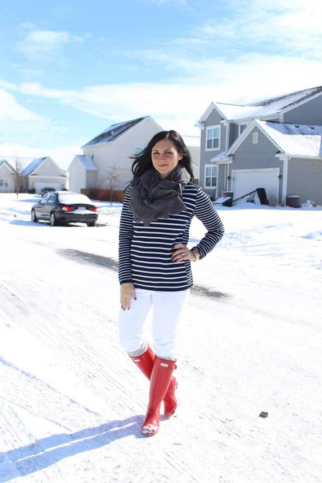 White jeans, red hunter boots, navy stripe sweater.