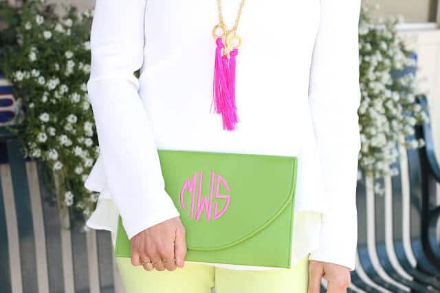 Shop Melvin tassel necklace, monogram clutch