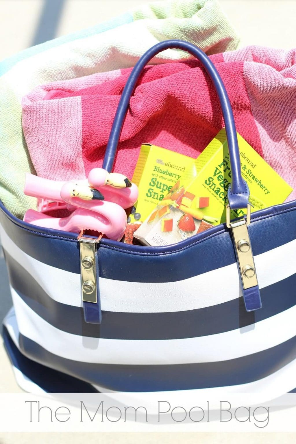 Mom Pool bag essentials with CVS Gold Emblem Abound