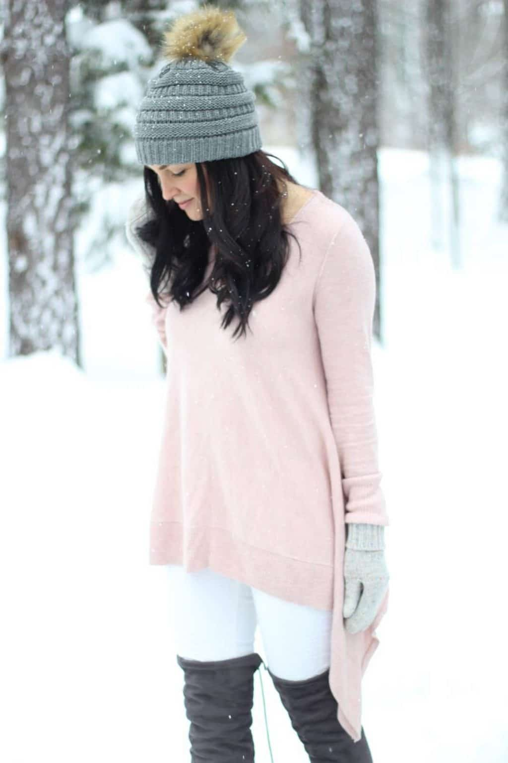 Over the knee boots with white jeans and pink sweater