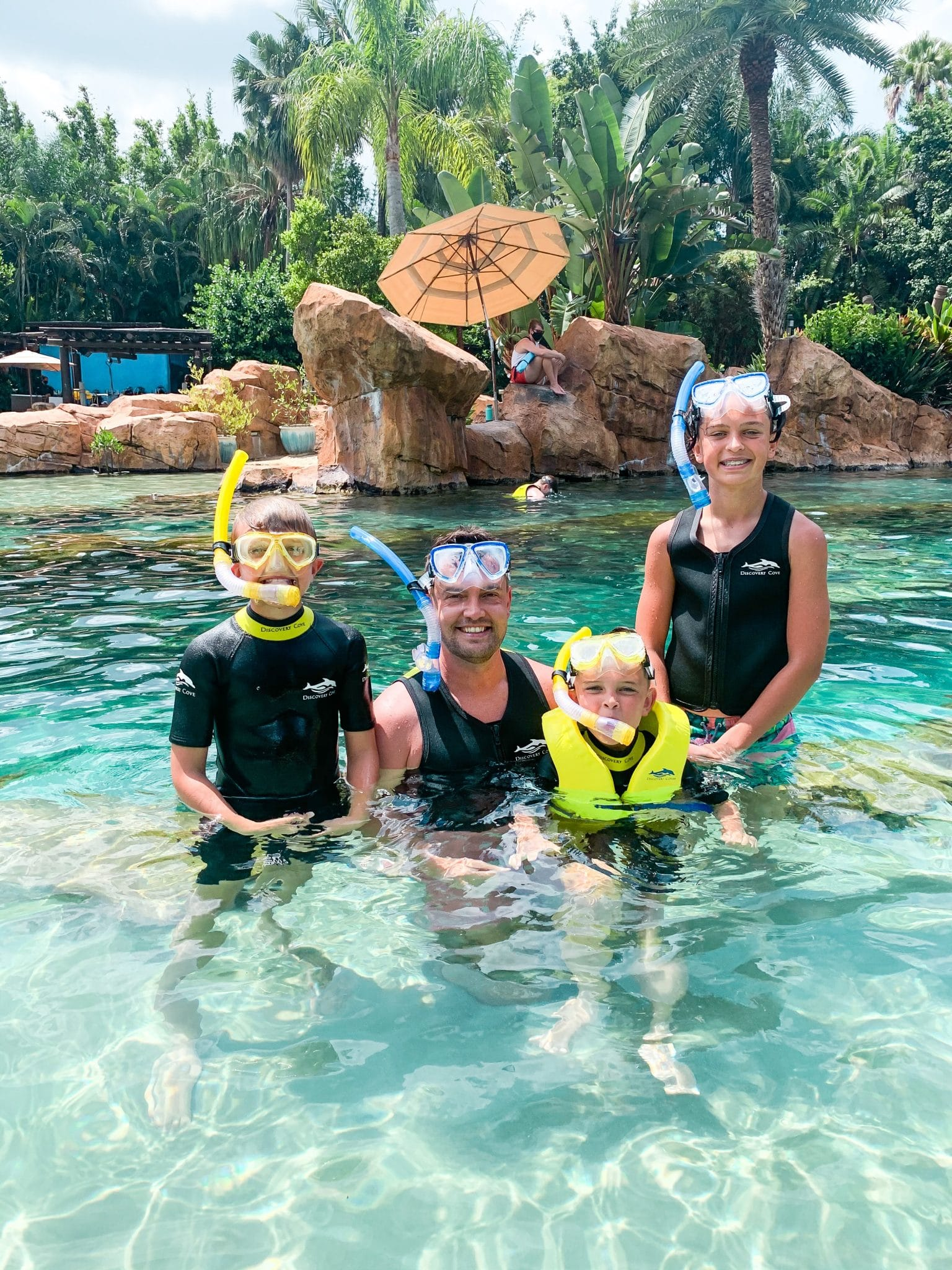 Discovery Cove All inclusive Florida resort, Kissimmee vacation, family travel, Stilettos and Diapers